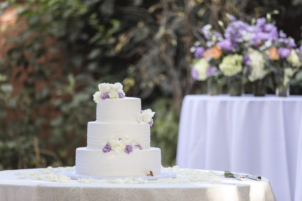 simple buttercream wedding cake with lavender flowers