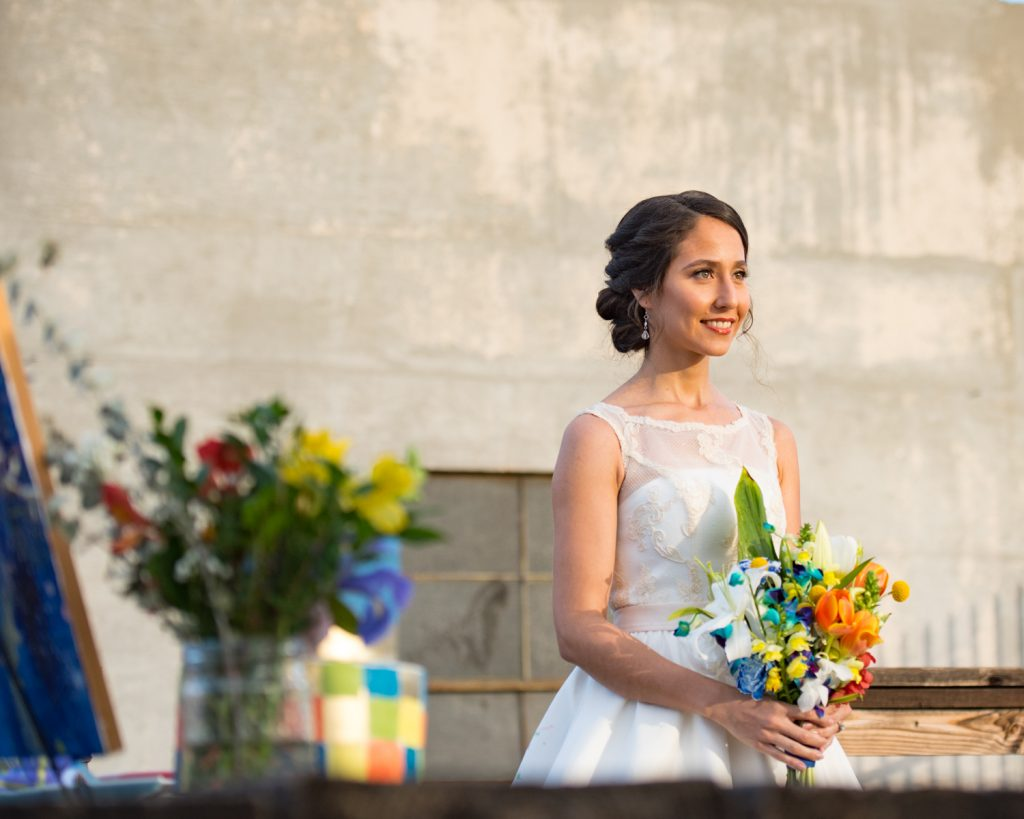 Radiant Bride with custom tea length dress and colorful bridal bouquet